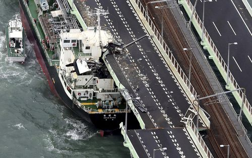 A tanker is seen after it slammed into the side of a bridge connecting the airport to the mainland, damaging part of the bridge and the vessel in Osaka, western Japan