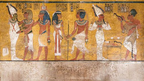 """This wall painting depicts three separate scenes. On the right, Ay, Tutankhamun's successor, performs the """"opening of the mouth"""" ceremony on Tutankhamun, who is depicted as Osiris, lord of the underworld. Picture: Courtesy of J Paul Getty Trust"""