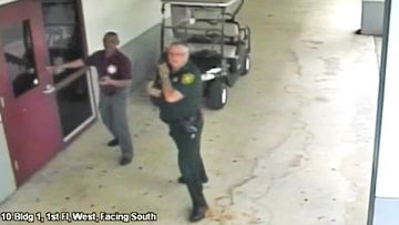 Scot Peterson, right, outside Marjory Stoneman Douglas High School in Parkland, Florida on March 15. Picture: AP