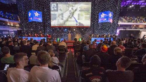 Gamers watch a cup game between Denmark and Australia playing Counter Strike Global Offensive in London last year. (AAP)