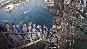 Chinese tourists climb the Sydney Harbour Bridge.