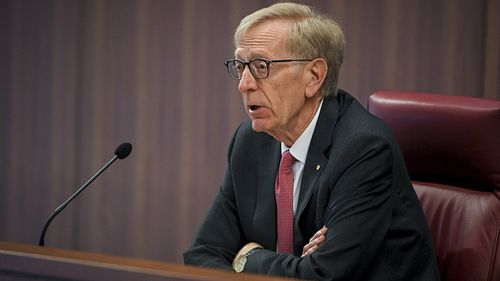 Former High Court judge and banking Royal Commissioner Kenneth Kayne QC put the institutions on warning today in the first hearing of the inquiry (AAP).