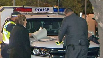 Detectives at the scene of an attack on a young Adelaide man.