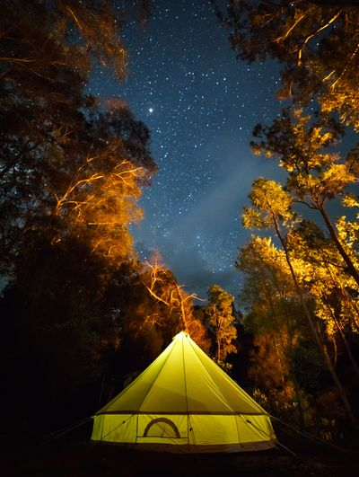 Family camp under the stars on the Colo River in NSW, Australia.