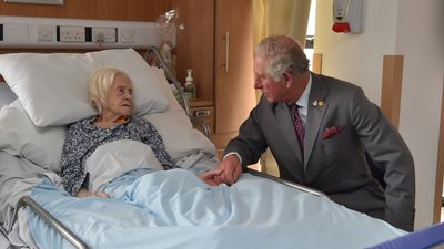 Prince Charles shares a touching moment with hospice patient Maureen Russell