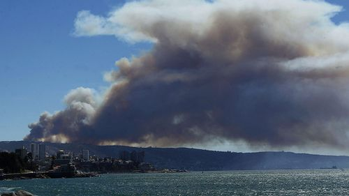 View of smoke from a forest fire in Valparaiso. (AAP)