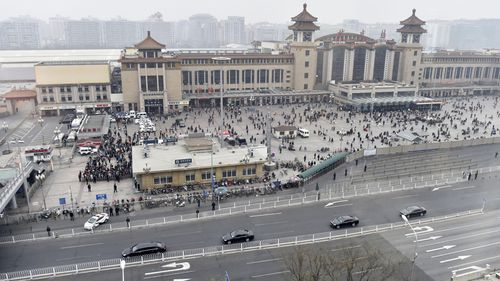 The train arrives at Beijing station with accompanying motorcade. Picture: AP