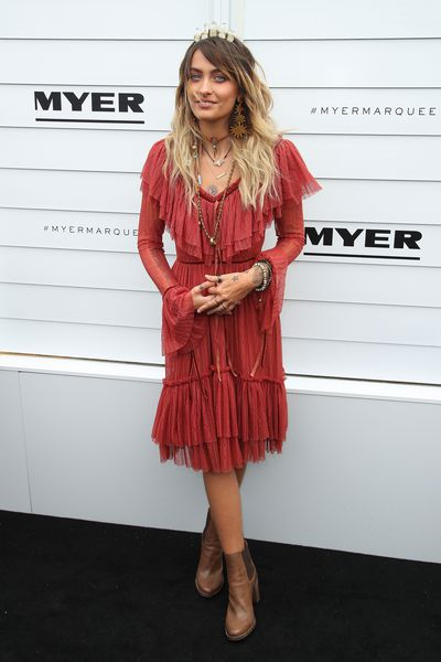 Paris Jackson in a dress by Morrison, a headpiece by Ann Shoebridge and her own desert boots.