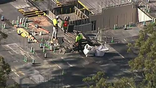 A construction worker in St Ives, in Sydney's north, was taken to hospital with head and chest injuries today after a fall on-site. Picture: 9NEWS.