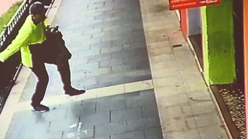The alleged gunman was captured on CCTV leaving the scene. (9NEWS)