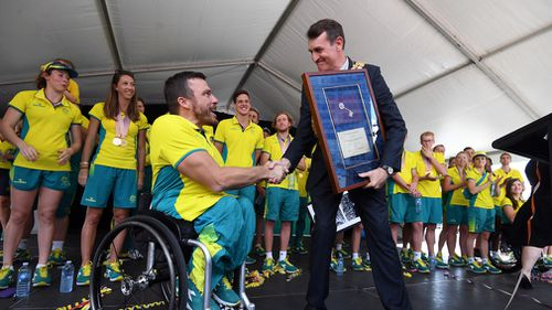 Gold medalist Kurt Fearnley of Australia during the medal ceremony for the T54 Marathon during the XXI Commonwealth Games on the Gold Coast. Picture: AAP