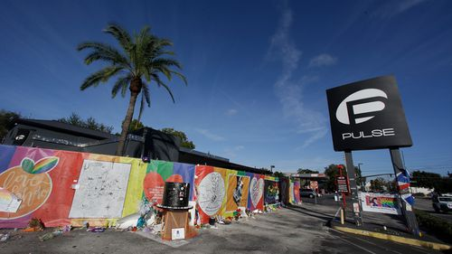 Artwork and signatures cover a fence around the Pulse nightclub, the scene of the mass shooting. (AP)