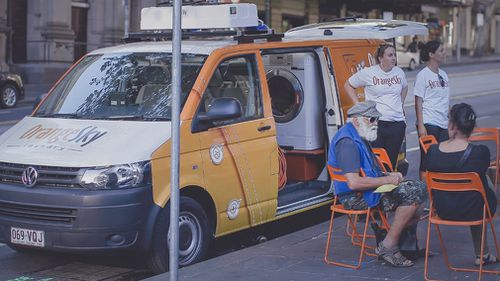 The mobile laundry service provides an important platform for conversation with its clients. (Supplied)