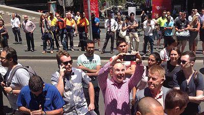 A man is shown taking a selfie near the scene.