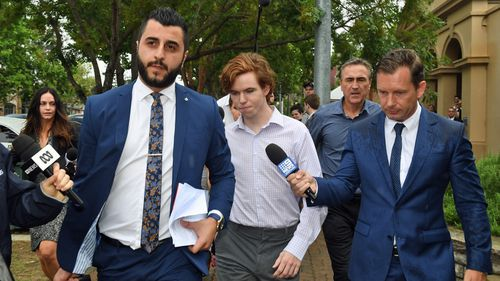 Luke Munday (centre) leaves the Camden Local Court in Sydney, Thursday, December 13, 2018.