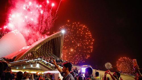 Fireworks explode over the Sydney Harbour Bridge and Sydney Opera House during the midnight display during New Year's Eve celebrations on January 01, 2020 in Sydney, Australia