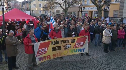Neo-Nazis marched through a German town unwittingly raised thousands of euros for an anti-Nazi charity. (AAP)