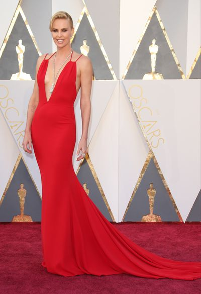 <p>Charlize Theron in Dior.</p> <p>Charlize is also under contract to Dior, spruiking their fragrance. The dress was chosen by Charlize's stylist Leslie Fremar just two weeks before the big night.  The Harry Winston necklace was a staggering 48.8 carats.</p>