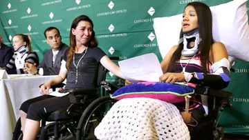 Circus acrobat Julissa Segrera, second from right, of the United States, and Dayana Costa, right, of Brazil, are tearful as Ms Costa reads a statement at Spaulding Rehabilitation Hospital in Boston. They were among the eight acrobats injured when the apparatus from which they were suspended fell, sending them plummeting to the ground during a performance.