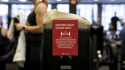 A sign advising customers too social distance while working out at a Fitness First Gym.