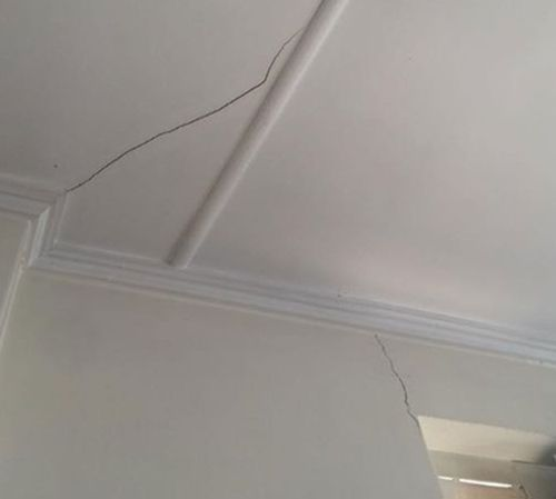 The cracks on the ceiling and wall of the apartment. (Angeline Darling)