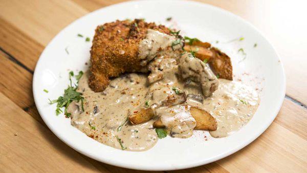 The Shahrouk's crumbed chicken with mushroom sauce