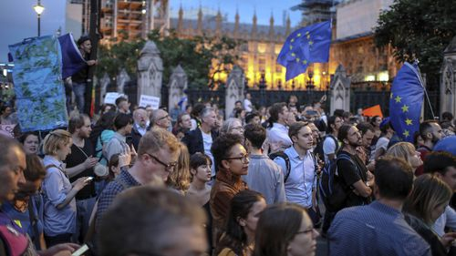 """Cries of """"shame on you"""" and """"stop the coup"""" were heard as protesters met outside parliament."""