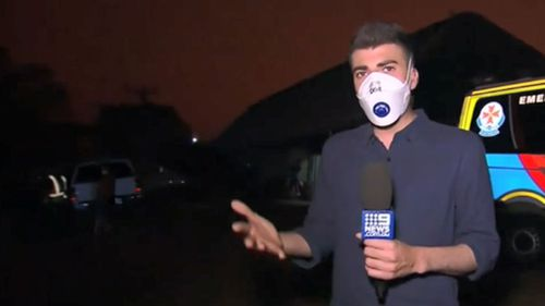 9News reporter Sam Cucchiara broadcasts after Mallacoota was once again plunged into darkness.