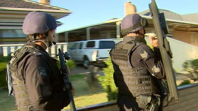 Man who shot at police during drug raid fronts court