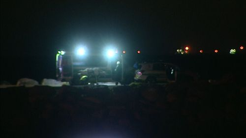 Emergency crews attend the scene of the accident last night.