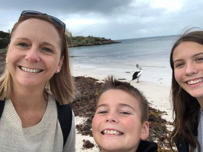 Tracey Lewis on a beach with her children