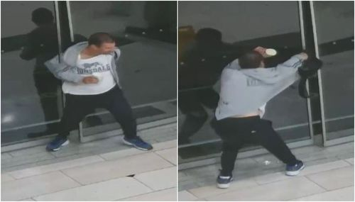 After getting his leg out from the glass, the thug tries to pull his back through the doors. (Supplied)