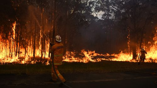 Sydney fire eases, firefighter recovers