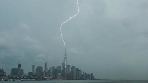A photo of lightning striking the One World Trade Centre. (@AnthonyQuintano)
