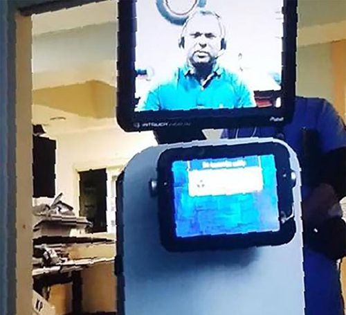 A picture released by Mr Quintana's grand daughter shows the robot doctor who came to his hospital room to tell him via video link he would soon die.