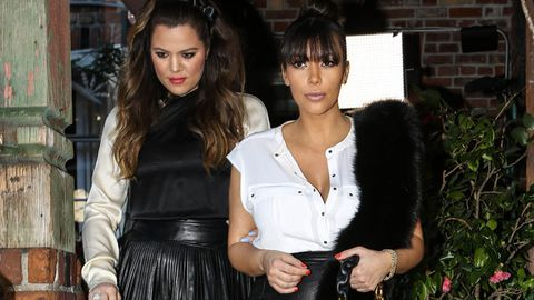 Khloe and Kim Kardashian leaving The Ivy restaurant in LA after shooting a segment for their show.