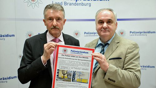 The Minister of the Interior of the state of Brandenburg, Karl-Heinz Schroter (left), and the President of the Police of the state of Brandenburg, Hans-Jurgen Morke, hold a wanted poster during a press conference on the case of a parcel bomb in Potsdam. (Photo: AP).