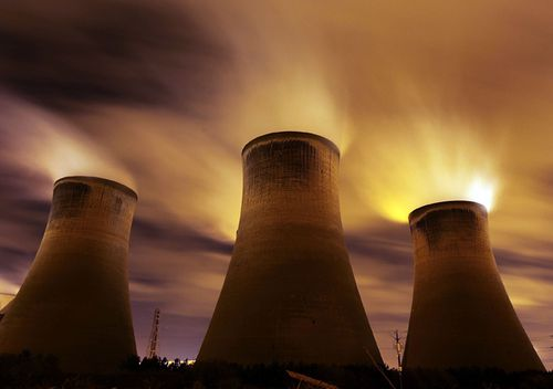 The coal fueled Fiddlers Ferry power station emits vapour into the night sky in Warrington, United Kingdom.