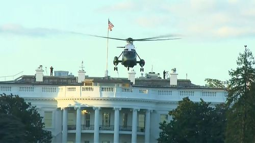 Marine One leaves the White House to take Donald Trump to hospital.