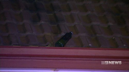 A second bottle was thrown onto Ms Baxter's roof. (9NEWS)