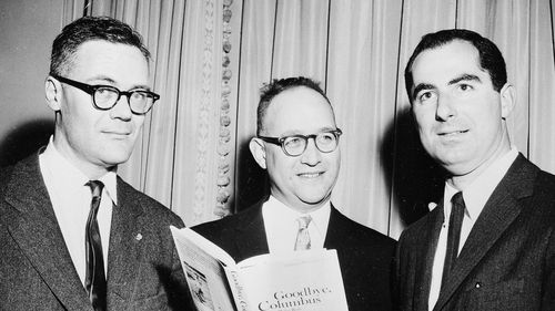 """In this March 24, 1960 file photo, the three winners of the National Book Award, Robert Lowell, from left, awarded for the most distinguished book of poetry, Richard Ellmann, won in the nonfiction category, and Philip Roth, received the award in the fiction category for his book """"Goodbye, Columbus,"""" pose at the Astor Hotel in New York City, Roth, prize-winning novelist and fearless narrator of sex, religion and mortality, has died at age 85."""