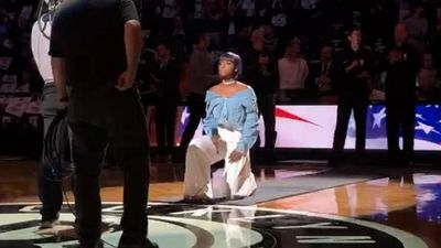 Anthem singer kneels at NBA game