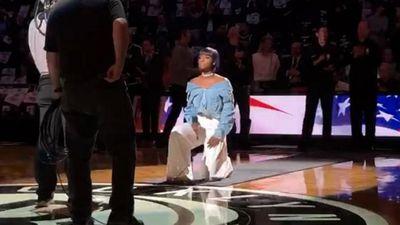 Anthem singer kneels at NBA game