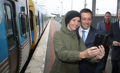 Mr Guy seizes the opportunity to take a selfie with a supporter at Cranbourne railway station, where the Coalition has pledged nearly $500 million to extend the Cranbourne to Clyde train line.