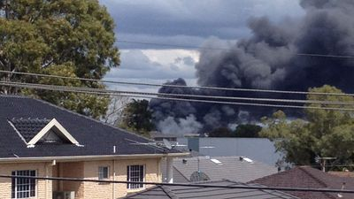 An image shows thick black smoke over a residential area. (Amour El)