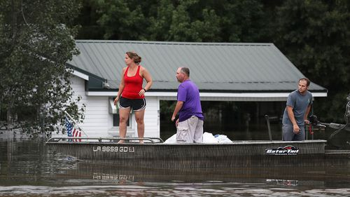 Good Samaritan pays for Louisiana flood victim's shopping after hearing she 'lost everything'