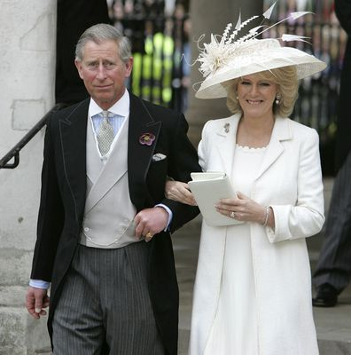 TRH Prince Charles, the Prince of Wales, and his wife Camilla, the Duchess of Cornwall, depart the Civil Ceremony where they were legally married, at The Guildhall, Windsor on April 9, 2005 in Berkshire, England.