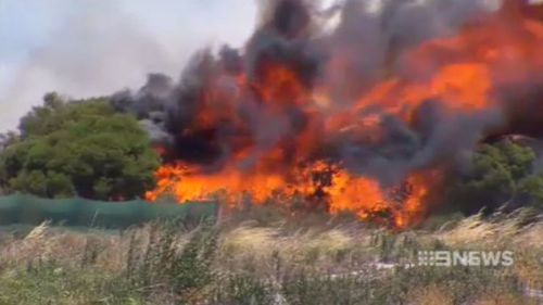 The fire is believed to be moving at 2km/hr aided by strong winds. (9NEWS)