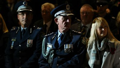 NSW Police Commissioner Andrew Scipione (centre) at the dawn service in Sydney. (AAP)