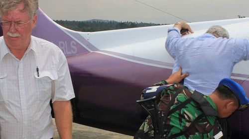 Pilots Graeme Paul Jackline and Richard Wayne McLean are patted down by Indonesian officials. (AAP)